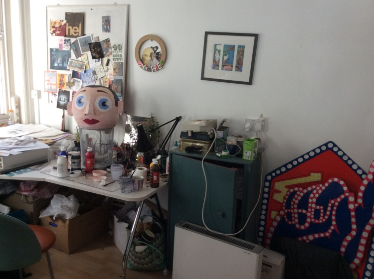 A huge papier mache head promoting the film 'Frank Sidebottom'.